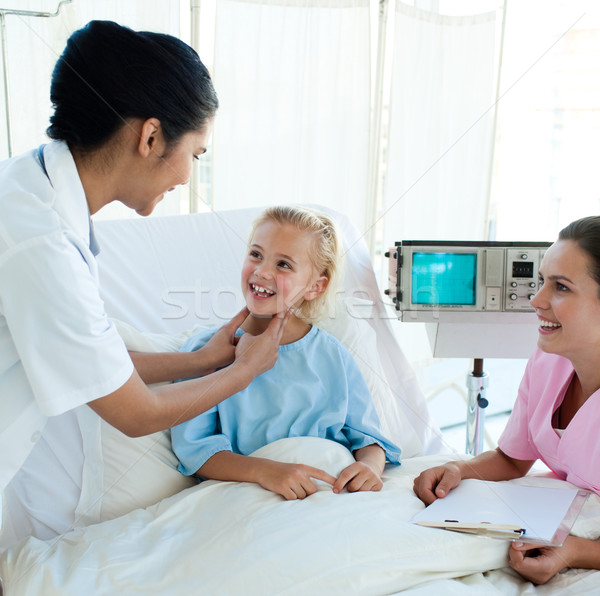Smiling doctor attending a young patient  Stock photo © wavebreak_media