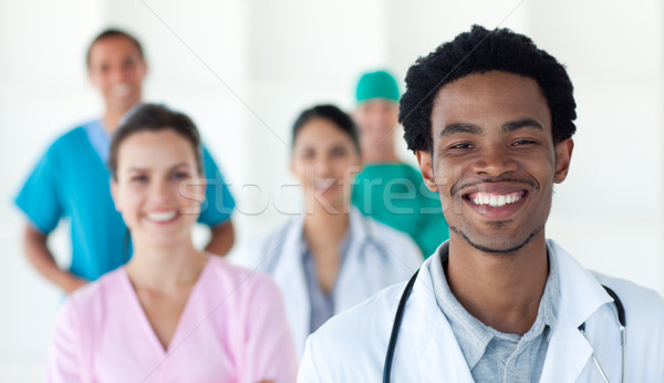 Stock photo: Multi-ethnic medical people smiling at the camera
