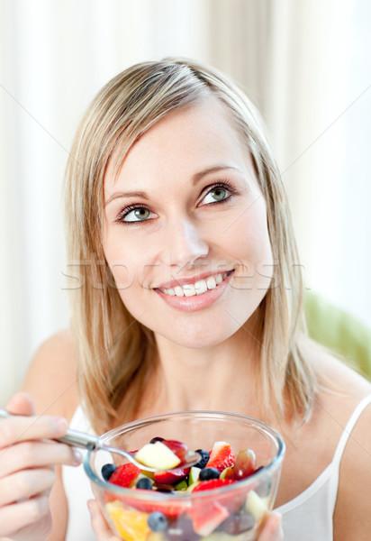 Radiant woman eating a fruit salad  Stock photo © wavebreak_media