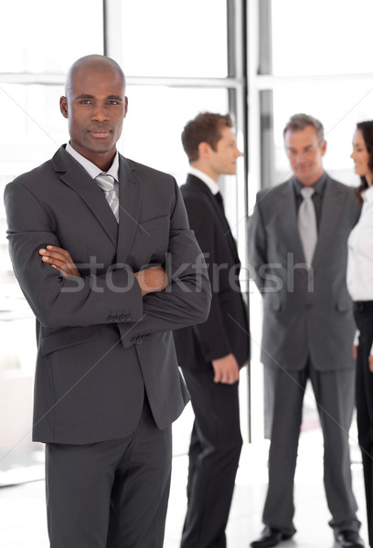 Young Businessman standing out from the Crowd Stock photo © wavebreak_media