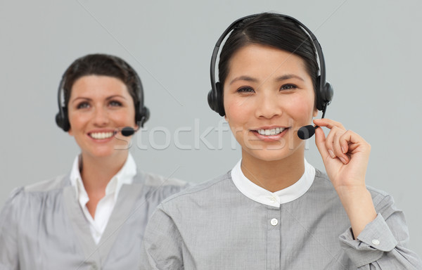 Female Customer service agents with headset on Stock photo © wavebreak_media