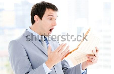 Portrait of a annoyed businessman reading a newspaper  Stock photo © wavebreak_media