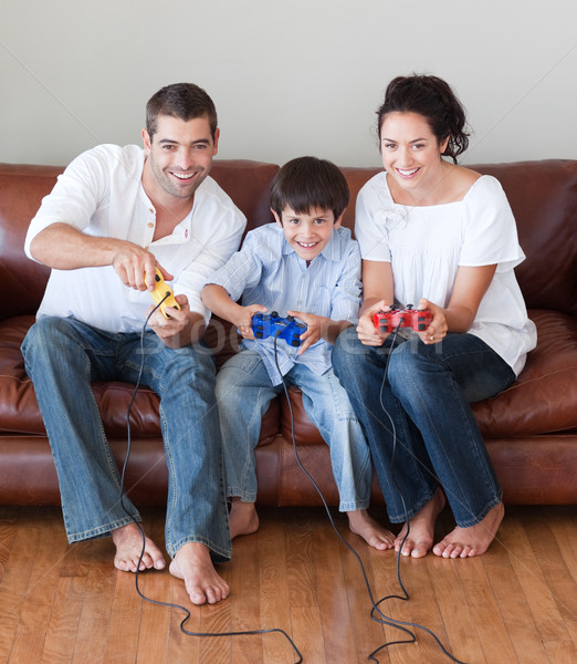 Young family playing in the living room video games Stock photo © wavebreak_media