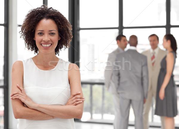 красивой деловая женщина оружия сложенный коллеги женщину Сток-фото © wavebreak_media