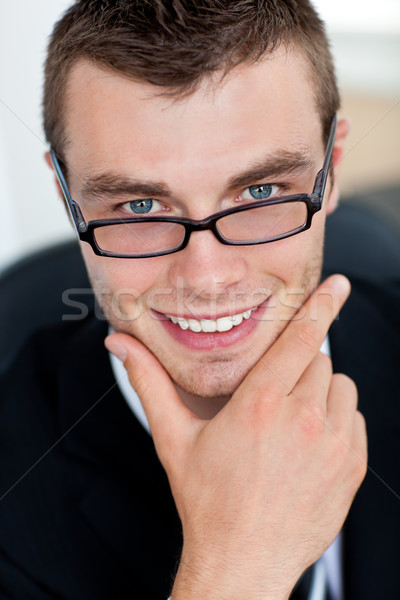 Stock photo: Smiling businessman with glasses in his office