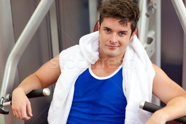 Handsome muscular man using a bench press Stock photo © wavebreak_media