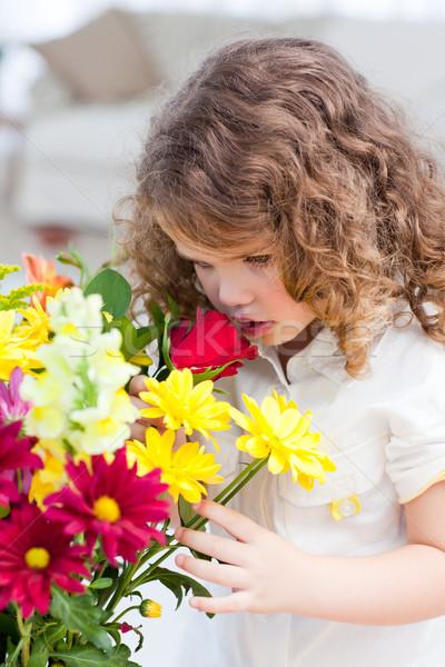 A little girl smelling  flowers Stock photo © wavebreak_media