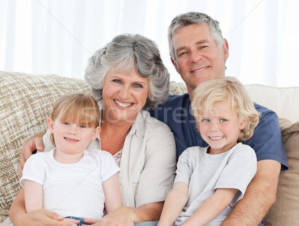 Joyful family looking at the camera at home Stock photo © wavebreak_media