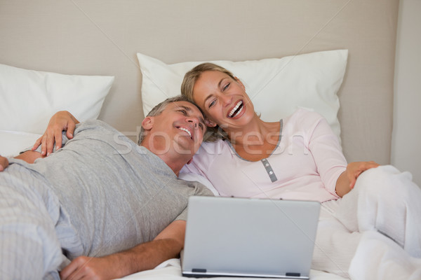 Lovely couple looking at their laptop Stock photo © wavebreak_media