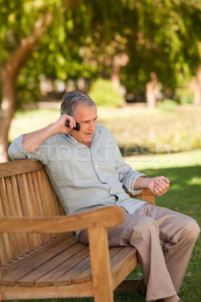 Mature man phoning in the park Stock photo © wavebreak_media