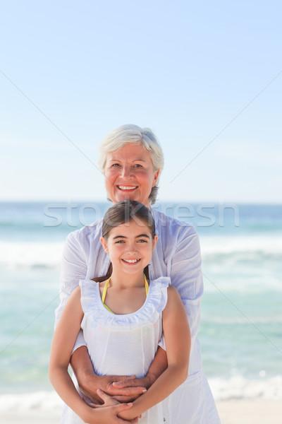 Grootmoeder kleindochter strand hemel water glimlach Stockfoto © wavebreak_media