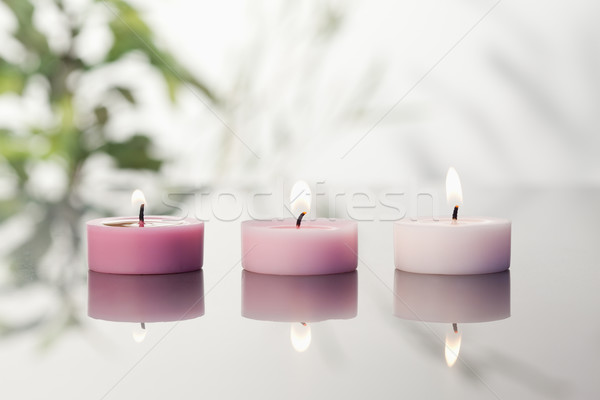 Lighted candles on a mirror Stock photo © wavebreak_media