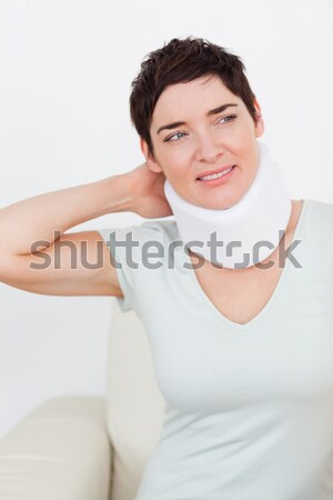 Close up of a short-haired woman with a surgical collar in a waiting room Stock photo © wavebreak_media
