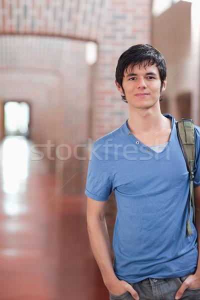 Portrait Homme étudiant posant couloir heureux Photo stock © wavebreak_media