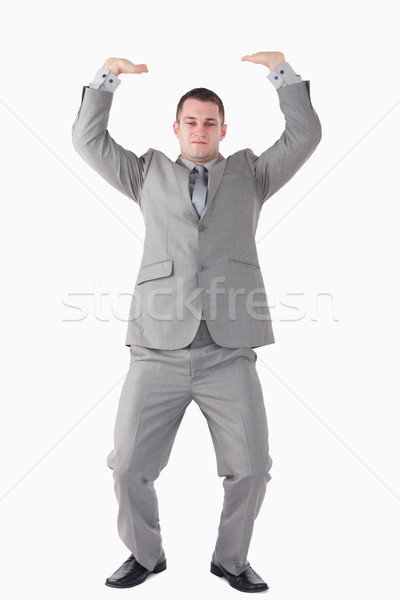 Portrait of a businessman pushing the roof against a white background Stock photo © wavebreak_media