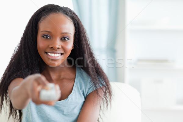 улыбающаяся женщина пультом технологий гостиной Lounge Сток-фото © wavebreak_media