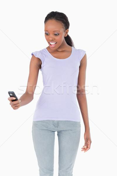 удивленный белый телефон Сток-фото © wavebreak_media