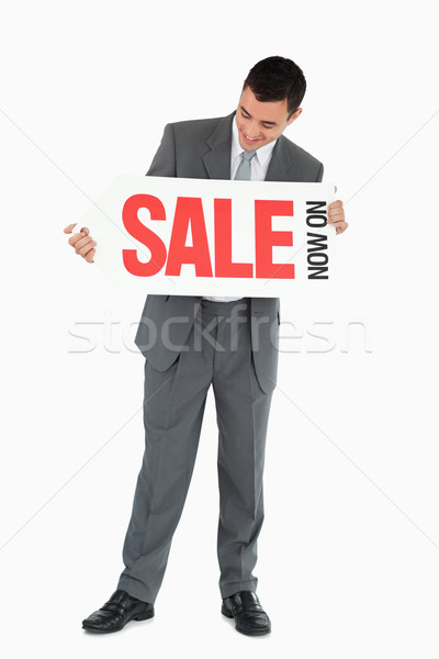 Businessman looking at signboard in his hands against a white background Stock photo © wavebreak_media