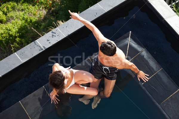 Above view of a young couple talking in a swimming pool Stock photo © wavebreak_media
