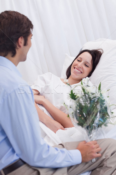 Young woman is happy about receiving a visit at the hospital Stock photo © wavebreak_media