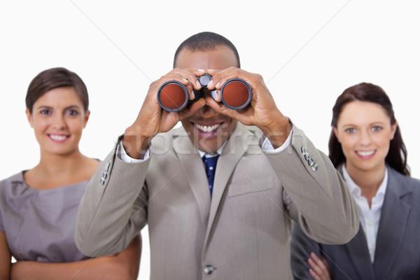 Souriant affaires collègues regarder jumelles blanche Photo stock © wavebreak_media