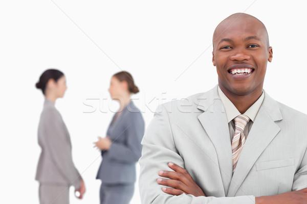 Uśmiechnięty handlowiec koledzy za biały działalności Zdjęcia stock © wavebreak_media