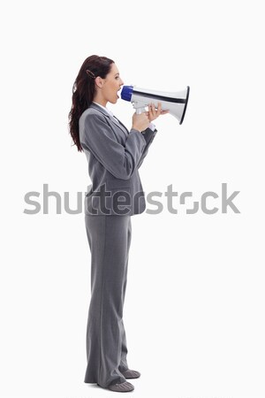 Profile of a businesswoman speaking loudly in a megaphone against white background Stock photo © wavebreak_media