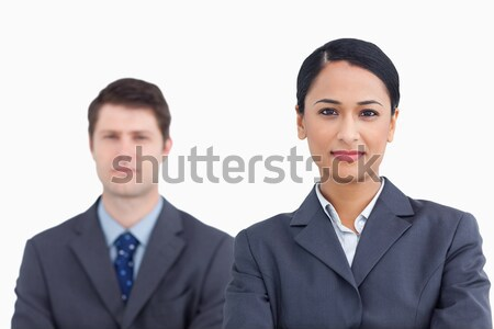 Close up of confident saleswoman with colleague behind her against a white background Stock photo © wavebreak_media