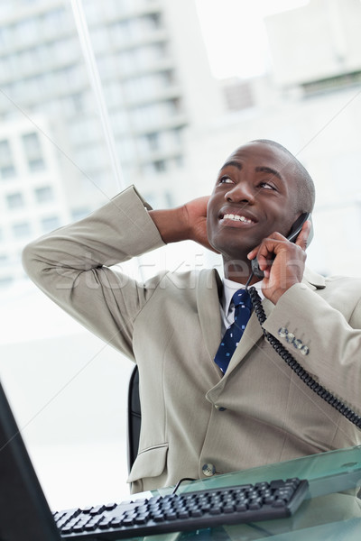 Portrait of a relaxed office worker on the phone looking away from the camera Stock photo © wavebreak_media
