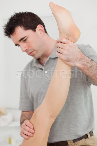 Chiropratico gamba paziente stanza uomo medici Foto d'archivio © wavebreak_media