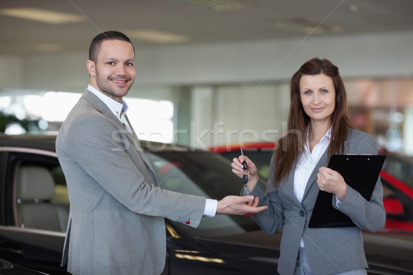 Woman giving car keys to a man in a dealership Stock photo © wavebreak_media