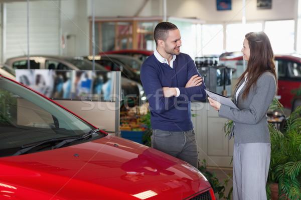 Man speaking to a businesswoman in a garage Stock photo © wavebreak_media