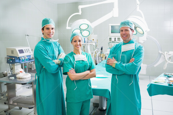 Surgeons with arms crossed smiling in an operating theatre Stock photo © wavebreak_media