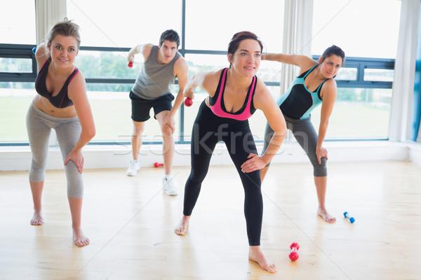 People in aerobics class lifting weights in fitness studio Stock photo © wavebreak_media