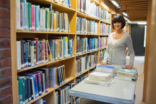 Librarian putting books back on shelf Stock photo © wavebreak_media
