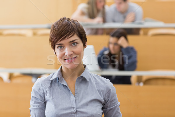 Woman standing at the lecture hall while smiling Stock photo © wavebreak_media