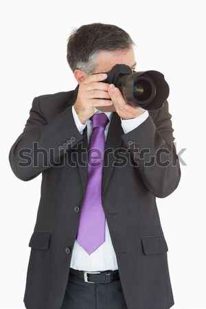 Businessman taking a picture on digital camera Stock photo © wavebreak_media