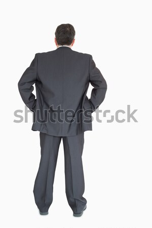 Businessman in suit standing back to the camera with hands on hip  Stock photo © wavebreak_media