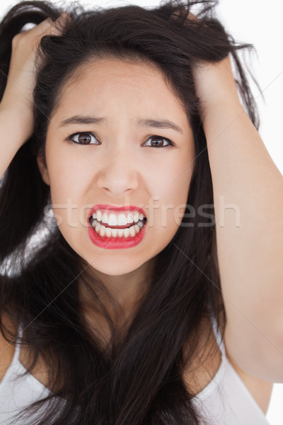 Woman looking shocked and angry against white background Stock photo © wavebreak_media
