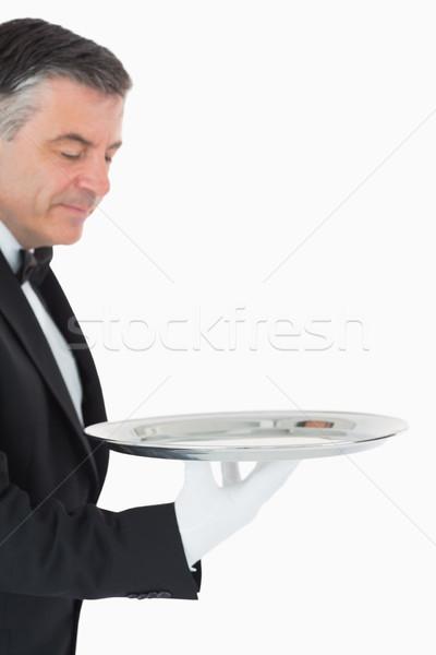 Cameriere guardando argento vassoio fotocamera Foto d'archivio © wavebreak_media