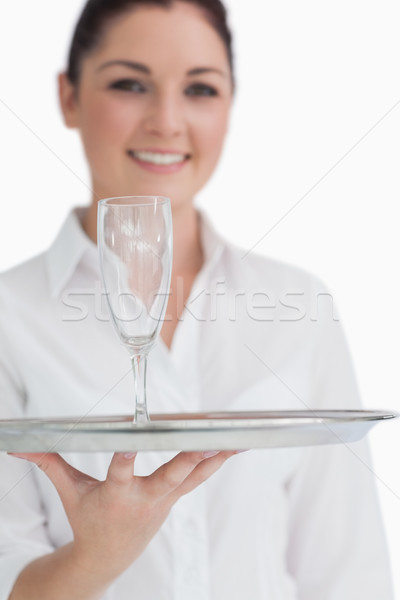 Close up of champagne glass on silver tray which is held by waitress Stock photo © wavebreak_media