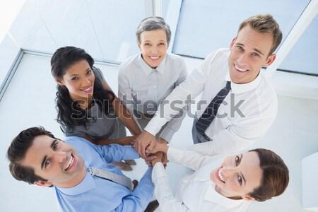 Csoport csapatmunka gyűlés kezek együtt munkahely Stock fotó © wavebreak_media