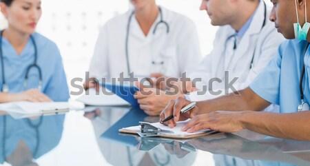 Orvosok megbeszélés kórház középső rész csoport fiatal Stock fotó © wavebreak_media