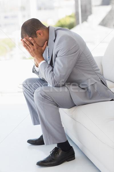 бизнесмен сидят диване голову рук Сток-фото © wavebreak_media