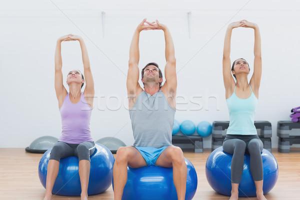 Insanlar yukarı eller egzersiz Stok fotoğraf © wavebreak_media