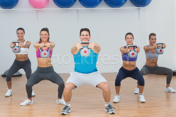 Class and instructor exercising with kettlebells in gym Stock photo © wavebreak_media