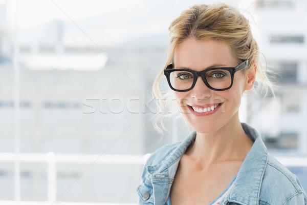 Pretty blonde designer smiling at camera Stock photo © wavebreak_media