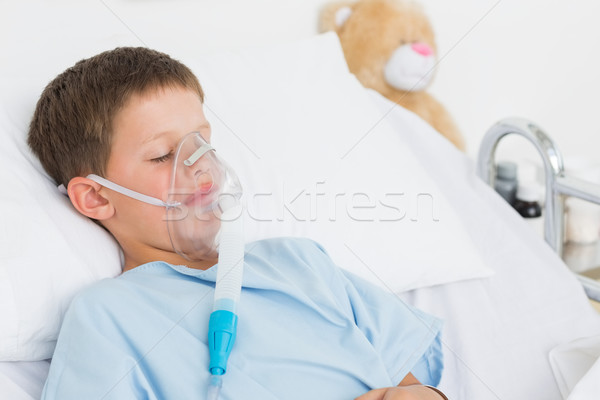 Boy with oxygen mask in bed Stock photo © wavebreak_media