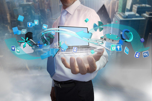Empresário aplicativo ícones laptop composição digital Foto stock © wavebreak_media