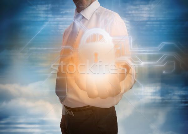 Businessman presenting lock graphic Stock photo © wavebreak_media